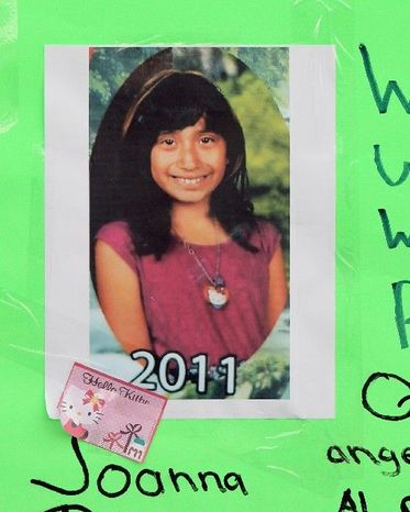 A memorial for Joanna Ramos, 10, stands outside Willard Elementary School in Long Beach, Calif. Joanna died in February after a confrontation with another girl, 11.