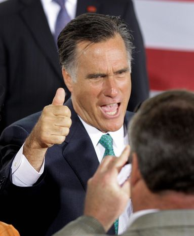 Former Massachusetts Gov. Mitt Romney, a Republican presidential candidate, gives the thumbs-up to supporters at a campaign stop in Charlotte, N.C., on Wednesday. Mr. Romney is in demand on the campaign trail as candidates for the Senate and House seek his help on the stump. (Associated Press)