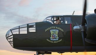 A B-25 Mitchell bomber slowly moves down the tarmac before taking off from Wright-Patterson Air Force Base on Wednesday to commemorate the attack by the Doolittle Raiders on Japan in 1942. (Andrew S. Geraci/The Washington Times)