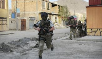 ** FILE ** In an April 15, 2012, file photo NATO soldiers run during a gun battle in Kabul, Afghanistan. The United States and its NATO allies are readying plans to pull away from the front lines in Afghanistan next year as President Barack Obama and fellow leaders try to show that the unpopular war is ending. (AP Photo/Musadeq Sadeq/file)