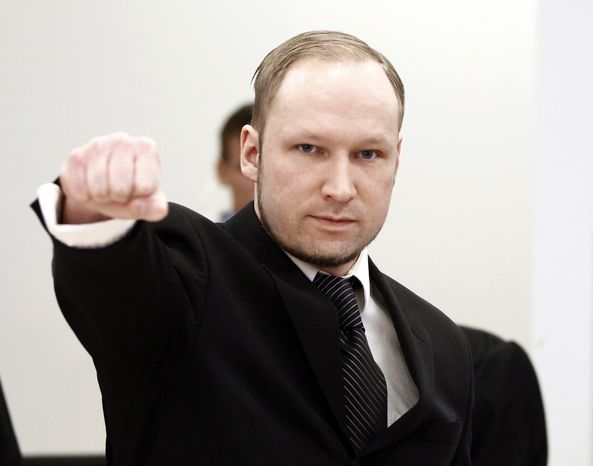 Accused Norwegian Anders Behring Breivik gestures April 18, 2012, upon his arrival at a courtroom in Oslo, Norway. Breivik is accused of detonating a bomb in July 2011 outside government headquarters in Oslo, killing eight people, then driving to a nearby resort island and massacring 69 others at a summer youth camp run by the governing Labor Party. (Associated Press/Scanpix Norway)