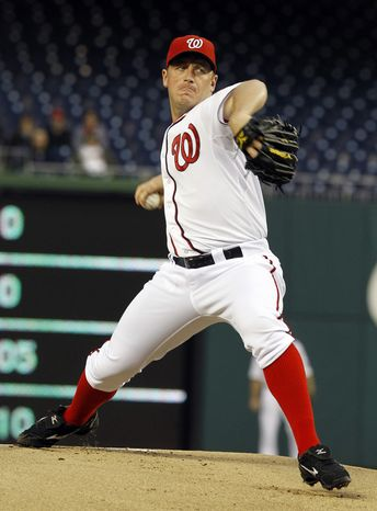 Washington Nationals starting pitcher Jordan Zimmermann delivers to the Houston Astros during the first inning in Washington on Wednesday, April 18, 2012. (AP Photo/Ann Heisenfelt)