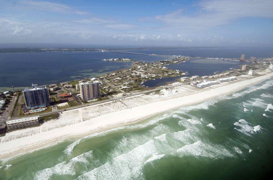 An aerial photo taken Monday April 16, 2012, shows the coast of Pensacola Beach, Fla., during a media helicopter flight organized by the BP Gulf Coast Restoration Organization. (AP Photo/Northwest Florida Daily News, Devon Ravine)