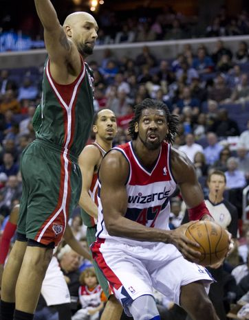 Washington Wizards center Nene shoots past Milwaukee Bucks power forward Drew Gooden during the second half in Washington, Wednesday, April 18, 2012. The Wizards won 121-112. (AP Photo/Manuel Balce Ceneta)