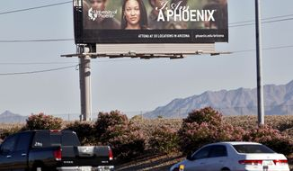 **FILE** A University of Phoenix billboard is shown Nov 24, 2009, in Chandler, Ariz. (Associated Press)