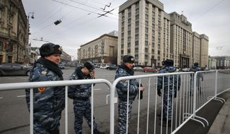 Russian police officers block the area outside the parliament building in Moscow, Wednesday, April 11, 2012. (AP Photo/Alexander Zemlianichenko)