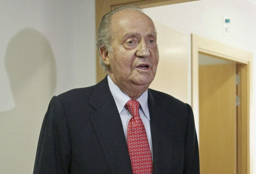 King Juan Carlos of Spain prepares to leave a hospital in Madrid on Wednesday, April 18, 2012, after undergoing hip replacement surgery. (AP Photo/Paco Campos, Pool)