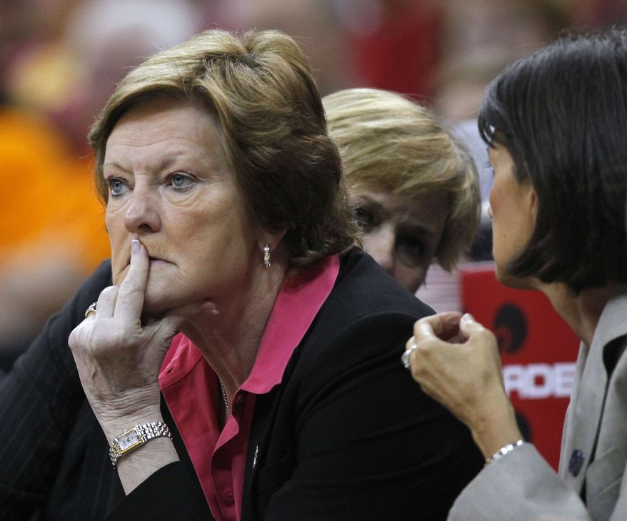 ** FILE ** Tennessee coach Pat Summitt follows her team in the second half of an NCAA women's college basketball tournament regional final against Baylor, with assistant coach Mickey DeMoss, right, talking to assistant head coach Holly Warlick, rear, Monday, March 26, 2012, in Des Moines, Iowa. Baylor won 77-58. (AP Photo/Nati Harnik)