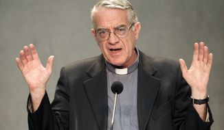 **FILE** Vatican spokesman Father Federico Lombardi speaks Sept. 2, 2011, during a press conference at the Holy See press office at the Vatican. (Associated Press)