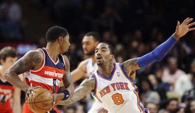 ** FILE ** New York Knicks' J.R. Smith (8) defends Washington Wizards' Roger Mason (8) during the first half of an NBA basketball game Friday, April 13, 2012, in New York. (AP Photo/Frank Franklin II)