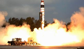 India's Agni-V missile, with a range of 3,100 miles, is launched in 2012 from Wheeler Island in the Bay of Bengal. The new nuclear-capable missile would give India the ability to strike major Chinese cities, though officials said the missile test should not be seen as a threat because India's missiles are intended only for deterrence. (Associated Press) ** FILE **