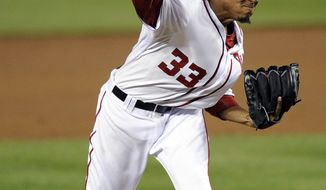 Washington Nationals starting pitcher Edwin Jackson delivers against the Houston Astros during the third inning Thursday, April 19, 2012, in Washington. (AP Photo/Nick Wass)