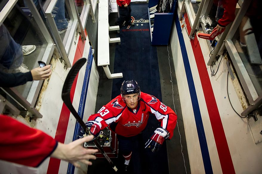 Washington Capitals center Jay Beagle (83) walks back to the locker room after warming up before the Caps took on the Boston Bruins in game four of the National Hockey League's first-round playoffs at the Verizon Center in Washington on Thursday, April 19, 2012. (Andrew Harnik/The Washington Times)