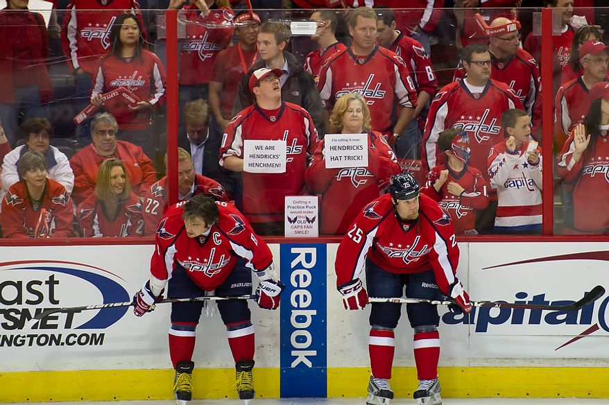 Washington Capitals left wing Alex Ovechkin (8) (left) and left wing Jason Chimera (25) (right) warm up before the Caps took to the ice against the Boston Bruins in game four of the National Hockey League's first-round playoffs at the Verizon Center in Washington on Thursday, April 19, 2012. (Andrew Harnik/The Washington Times)