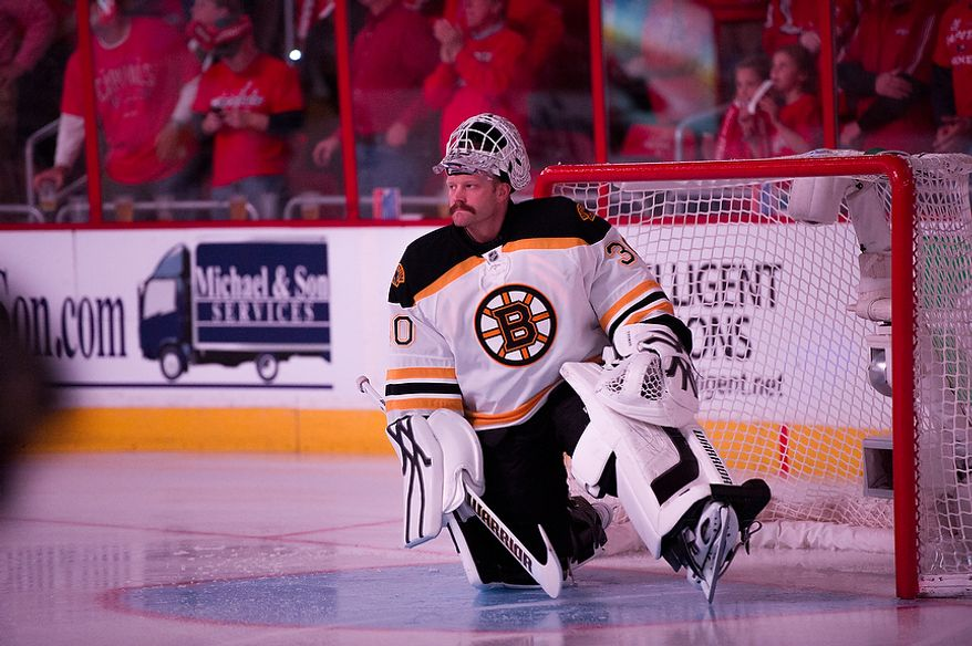 Boston Bruins goalie Tim Thomas (30) stretches just before the puck drops as the Washington Capitals took on the Bruins in game four of the National Hockey League's first-round playoffs at the Verizon Center in Washington on Thursday, April 19, 2012. (Andrew Harnik/The Washington Times)