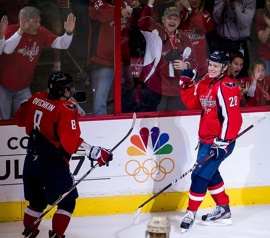 Washington Capitals left wing Alex Ovechkin (8) (left) comes over to celebrate with Caps left wing Alexander Semin (28) as he scores to bring the Capitals up 2-1 in the second period as Washington took on Boston in game four of the National Hockey League's first-round playoffs at the Verizon Center in Washington on Thursday, April 19, 2012. (Andrew Harnik/The Washington Times)