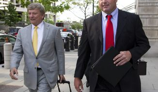 Former Major League Baseball pitcher Roger Clemens (right) and his lawyer Rusty Hardin leave a federal courthouse in Washington on April 17, 2012, as the second day of jury selection in his perjury trial wraps up. (Associated Press)