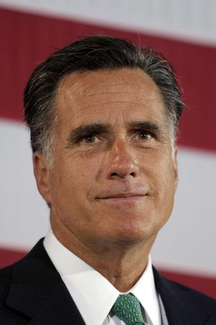 Republican presidential candidate, former Massachusetts Gov. Mitt Romney pauses while addressing supporters at his campaign stop in Charlotte, N.C., Wednesday, April 18, 2012. (AP Photo/Jae C. Hong)