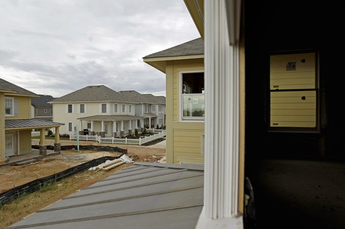 **FILE** New homes are seen March 23, 2012, under construction in a development in Atlanta. (Associated Press)