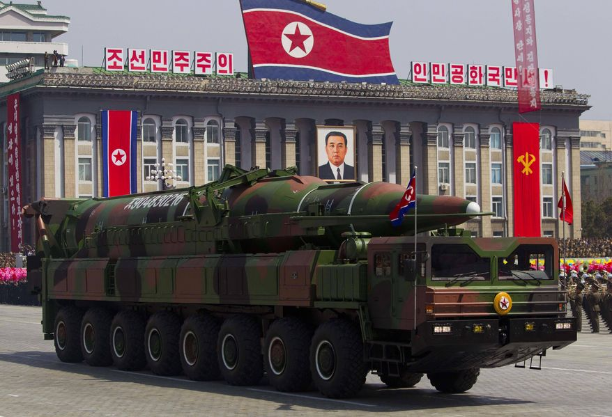 ** FILE ** In this April 15, 2012, file photo, a North Korean vehicle carrying a missile passes by during a mass military parade in Pyongyang's Kim Il Sung Square to celebrate the centenary of the birth of the late North Korean founder Kim Il Sung. The enormous, 16-wheel truck used to carry the missile, likely came from China in a possible violation of U.N. sanctions meant to rein in Pyongyang's missile program, experts say. (AP Photo/David Guttenfelder, File)