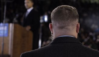 **FILE** A Secret Service agent stands Oct. 28, 2008, near then-presidential candidate Barack Obama at a rally in Norfolk, Va. (Associated Press)