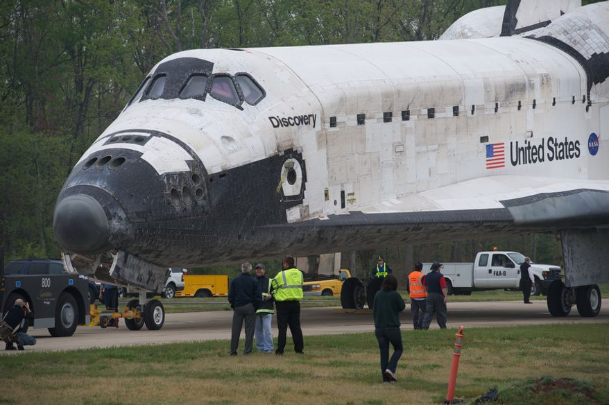 The NASA Space Shuttle Discovery sits on a road prior to a welcoming ceremony at the Smithsonian's National Air and Space Museum annex in Chantilly, Va., on April 19, 2012. (Rod Lamkey Jr./The Washington Times)