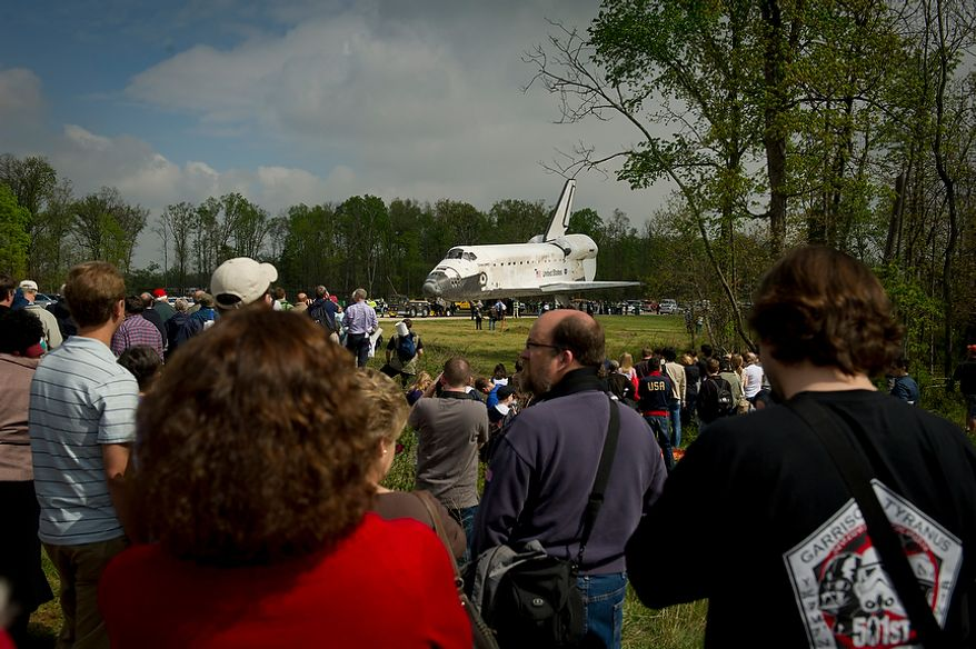 The NASA space shuttle Discovery is prepared to be moved to a location in front of the riser for the ceremony after its arrival at the National Air and Space Museum's Steven F. Udvar-Hazy Center in Chantilly, Va., on Thursday, April 19, 2012. (Rod Lamkey Jr./The Washington Times)