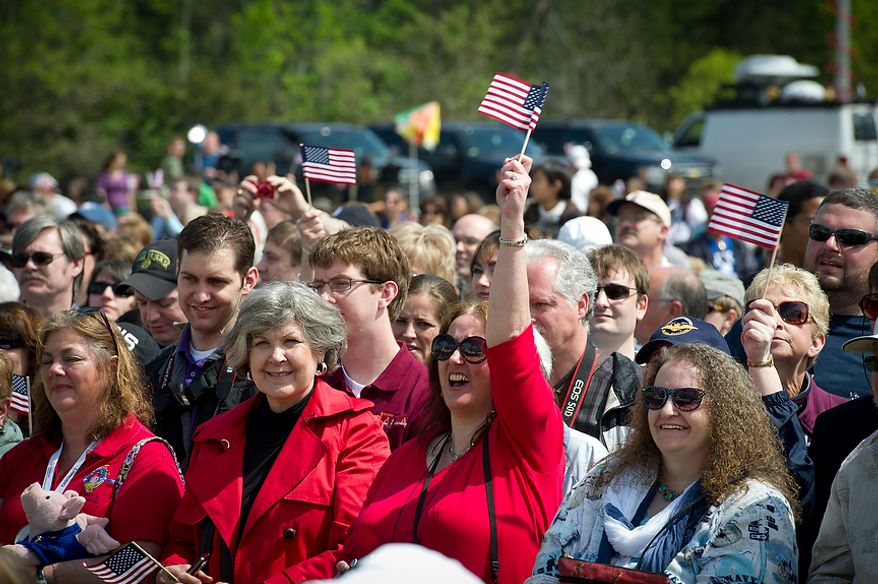 People watch the the ceremonial arrival of the NASA space shuttle Discoveryat the National Air and Space Museum's Steven F. Udvar-Hazy Center in Chantilly, Va., on Thursday, April 19, 2012. (Rod Lamkey Jr./The Washington Times)