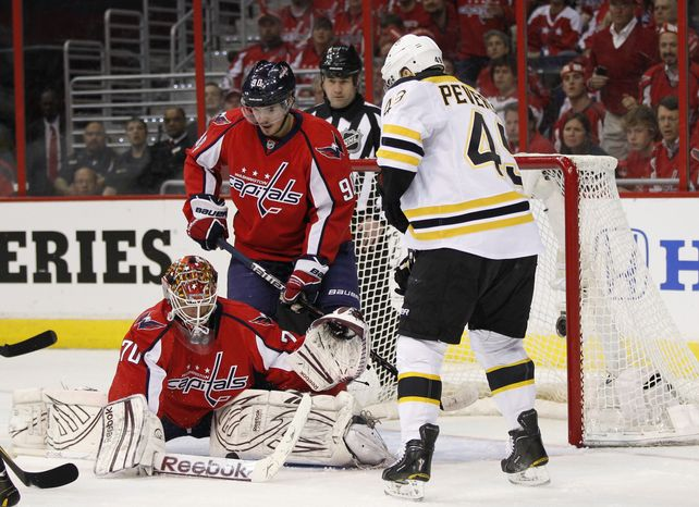 Washington Capitals goalie Braden Holtby makes a save against the Boston Bruins during the first period of Game 4 in the first-round series on Thursday, April 19, 2012 in Washington. (AP Photo/Evan Vucci)