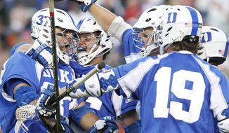 Duke lacrosse, shown celebrating a goal against Virginia, defeated Maryland on Friday, 6-5. (AP Photo/The Daily Progress, Sabrina Schaeffer)