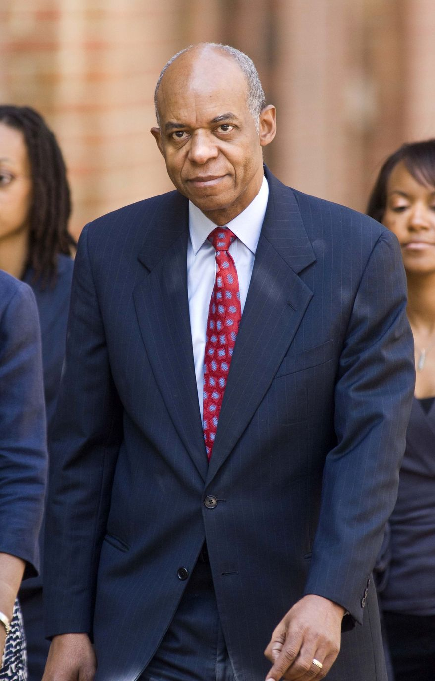 ** FILE ** In this Aug. 5, 2009, file photo, former Louisiana Rep. William Jefferson walks to federal court in Alexandria, Va. The former Louisiana congressman convicted of taking bribes will have to begin serving a 13-year prison sentence within two weeks. (AP Photo/Kevin Wolf, File)