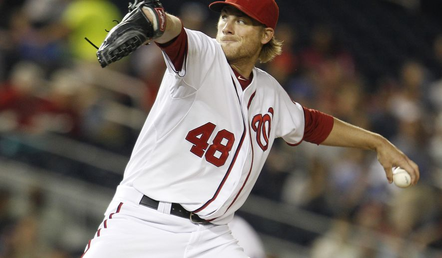 Washington Nationals starting pitcher Ross Detwiler delivers during the fourth inning against the Miami Marlins on Friday, April 20, 2012, in Washington. The Nationals defeated the Marlins 2-0. (AP Photo/Evan Vucci)