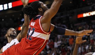 Washington Wizards' Nene scores the the game-winning basket against the Miami Heat in Miami on Saturday, April 21, 2012. (AP Photo/Alan Diaz)