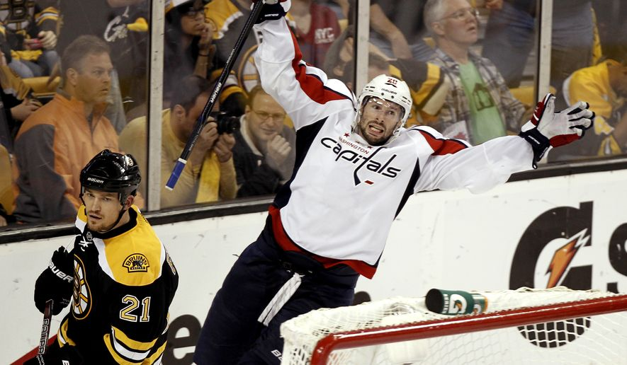 ** FILE ** Washington Capitals' Troy Brouwer celebrates his winning goal as Boston Bruins defenseman Andrew Ference (21) skates away during the third period of Washington's 4-3 win in Game 5 of the first-round series in Boston on Saturday, April 21, 2012. (AP Photo/Winslow Townson)