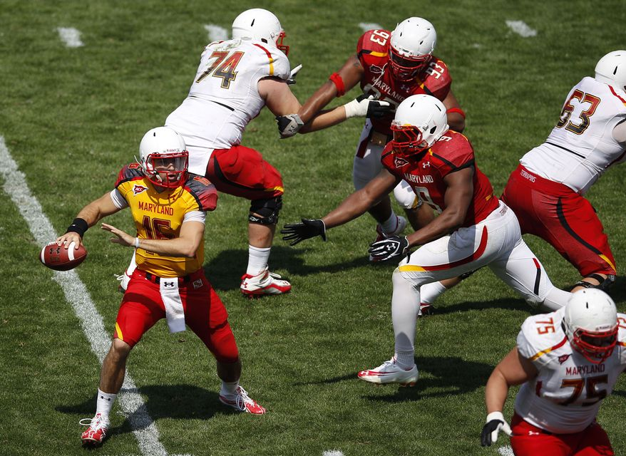 Maryland quarterback C.J. Brown looks for a receiver as he is pressured in the second half of the team's annual Red-White spring NCAA college football scrimmage in College Park, Md., on Saturday, April 21, 2012. (AP Photo/Patrick Semansky)