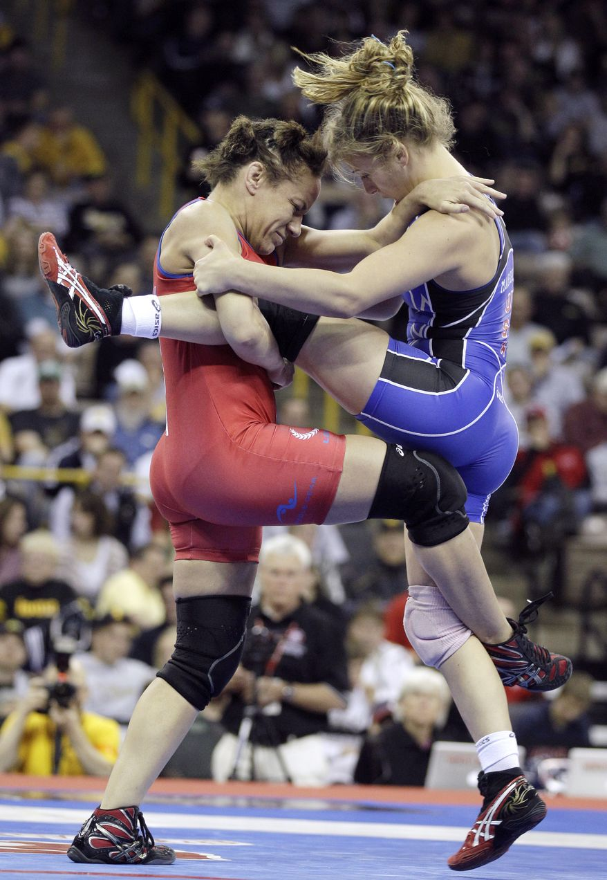 Kelsey Campbell, of Milwaukie, Ore., lifts Helen Maroulis, of Rockville, Md., right, off the mat in their 55 kg freestyle finals match at the U.S. Olympic Wrestling Team Trials on Saturday, April 21, 2012, in Iowa City, Iowa. (AP Photo/Charlie Neibergall)