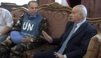 This image made from video made available by Syrian TV shows U.N. observer team leader Col. Ahmed Himmiche, left, meeting with the governor of Homs, Syria, Saturday, April 21, 2012. (AP Photo/Syria TV via AP video) TV OUT SYRIA OUT