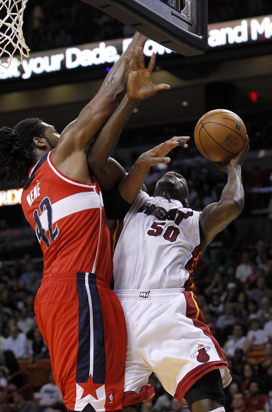 Washington Wizards' Nene (42) prepares to block a shot by Miami Heat's Joel Anthony (50) in the first half of an NBA basketball game in Miami, Saturday, April 21, 2012. (AP Photo/Alan Diaz)