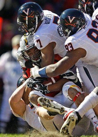 ** FILE ** Maryland running back Justus Pickett, shown against Virginia last fall. (Associated Press)