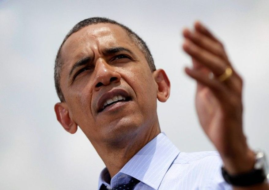 """""""This is a question of values. We cannot let America become a country where a shrinking number of people do really well while a growing number of people struggle to get by,"""" said President Obama. (Associated Press)"""