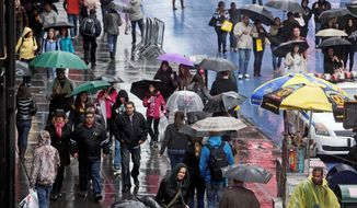 Umbrellas were everywhere in New York's Times Square on Sunday as a spring nor'easter brought consistent rain to a rain-starved East Coast. (Associated Press)