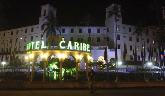 Pedestrians pass the Hotel Caribe in Cartagena, Colombia, late on Thursday, April 19, 2012. U.S. Secret Service employees and military personnel were accused of misconduct in connection with a prostitution scandal at the hotel before President Obama's arrival for the Summit of the Americas. (AP Photo/Pedro Mendoza) ** FILE **