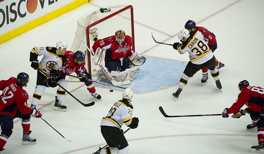 John Erskine (4) of the Washington Capitals defends against a shot by the Boston Bruins in the second period of the Eastern Conference Quarterfinals Game 6 at the Verizon Center in Washington, D.C., Sunday, April 22, 2012. (Rod Lamkey Jr/The Washington Times)