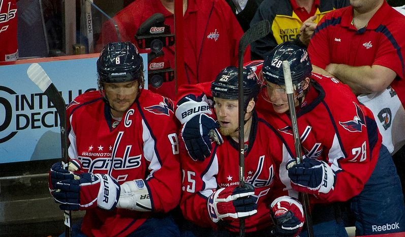 Jason Chimera (25) of the Washington Capitals (center) is congratulated by teammates Alex Ovechkin (8) and Alexander Semin (28) after scoring against the Boston Bruins to tie the score at 2 in the second period of the Eastern Conference Quarterfinals Game 6 at the Verizon Center in Washington, D.C., Sunday, April 22, 2012. (Rod Lamkey Jr/The Washington Times)