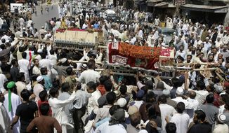 On Sunday, April 22, 2012, relatives and other mourners in Karachi, Pakistan, carry the coffins of a couple who were killed in the crash of a Bhoja Air Boeing 737 on the outskirts of Islamabad on Friday. All 127 people on board died. (AP Photo)