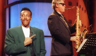 Presidential candidate Bill Clinton set the stage for other politicians to appear with pop culture figures in the search for young voters. In 1992, he played the saxophone on the late-night show hosted by Arsenio Hall. (Associated Press)