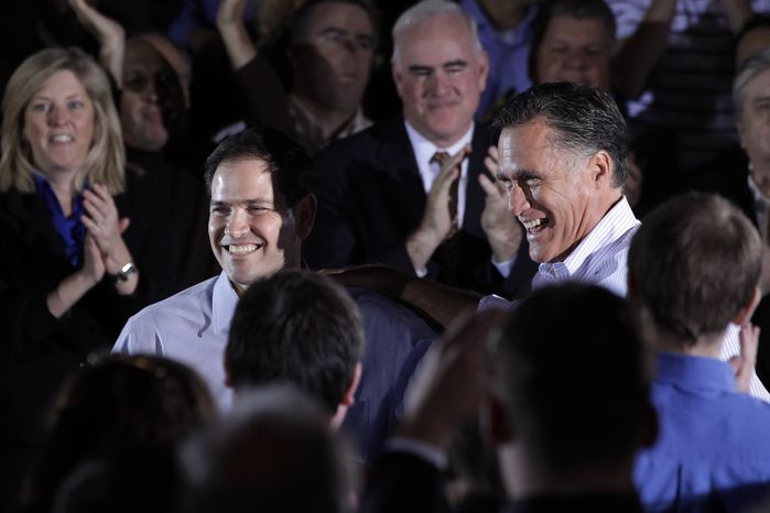 Republican presidential candidate, former Massachusetts Gov. Mitt Romney is joined by Sen. Marco Rubio, R-Fla., during a town hall-style meeting in Aston, Pa., Monday, April 23, 2012. (AP Photo/Jae C. Hong)