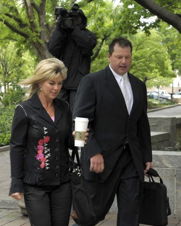 Retired Major League baseball pitcher Roger Clemens, and his wife Debra Lynn Godfrey, arrive at federal court in Washington, Monday, April 23, 2012. The Clemens perjury trial moves into the next phase with the planned seating of a jury and opening arguments on Monday. (AP Photo/Susan Walsh)