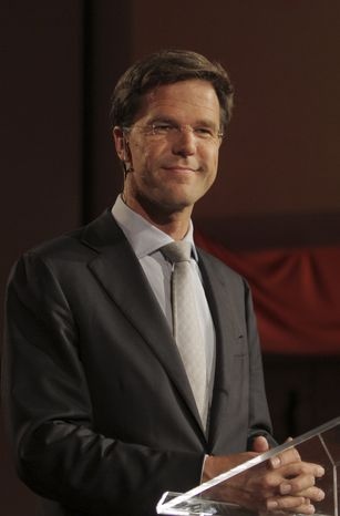 **FILE** Dutch Prime Minister Mark Rutte of the free-market Liberal Party waits June 7, 2010, for the start of a televised election debate at the Erasmus University in Rotterdam, Netherlands. (Associated Press)