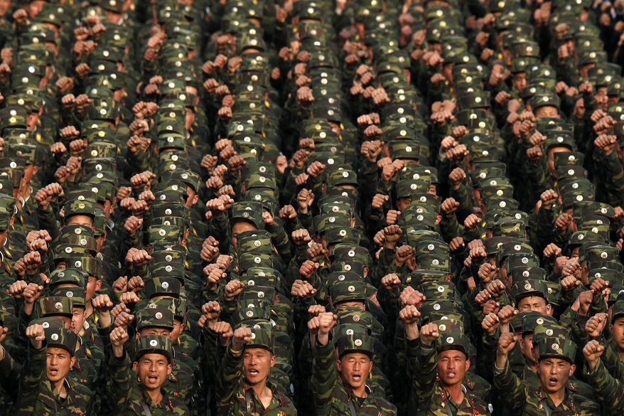 North Korean soldiers in Kim Il-sung Square in central Pyongyang, North Korea, chant during a rally denouncing South Korean President Lee Myung-bak on Friday, April 20, 2012. (AP Photo/Ng Han Guan)